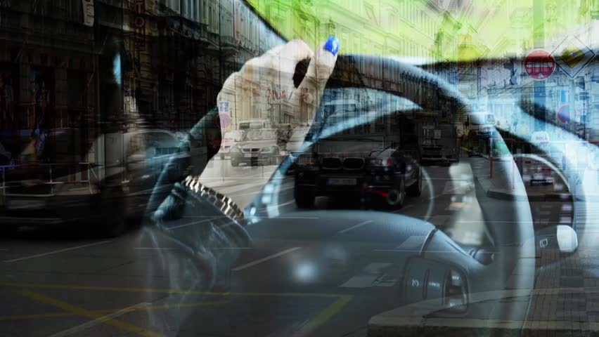 Woman drives a car - closeup - wheel and hand - urban street with passing cars - people - buildings | Shutterstock HD Video #10009229