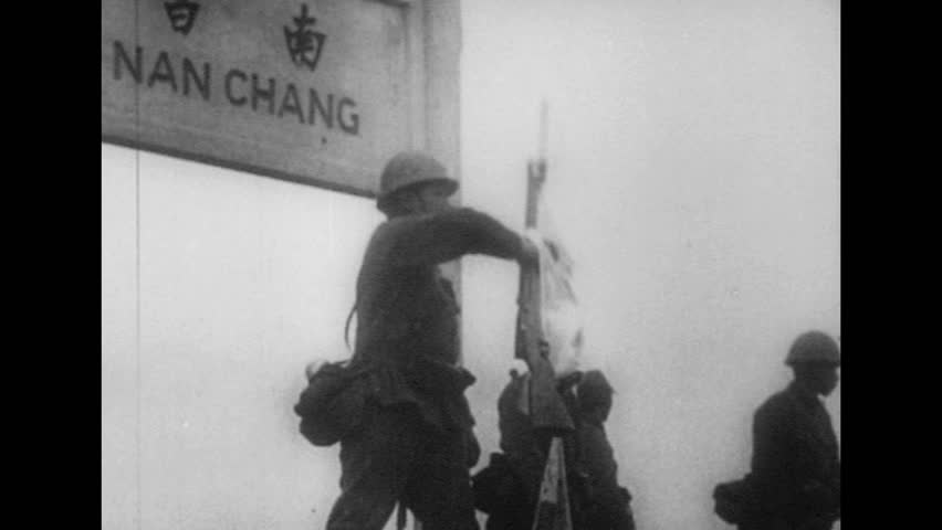 UNITED STATES 1940s: Japanese soldier waves flag / Soldiers salute / Long shot of soldiers saluting / Pan of soldiers saluting / Japanese flag / Car drives through gate. | Shutterstock HD Video #10010999