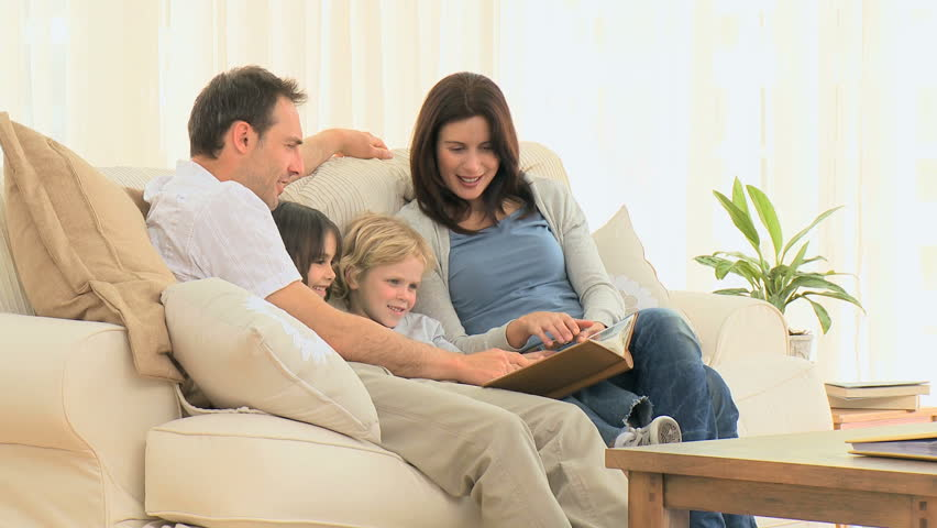 Wonderful Stock Video Of Lovely Family Looking At An Album | 1004869 | Shutterstock