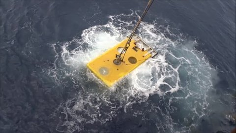Remote Operated Vehicle (ROV) floating and ready to dive for oil and gas pipeline inspection in the South China Sea.