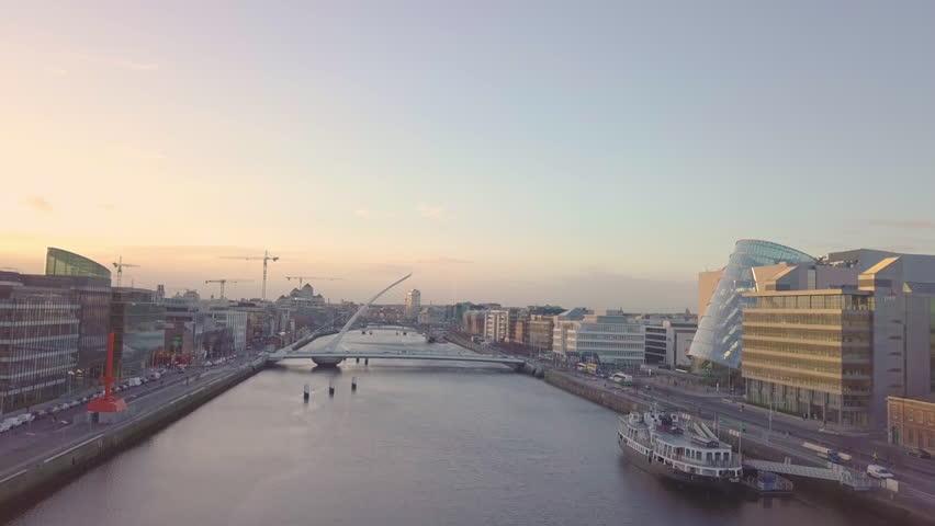 Dublin City Centre Aerial - Samuel Beckett Bridge at Sunset including Convention Centre | Shutterstock HD Video #1005619609