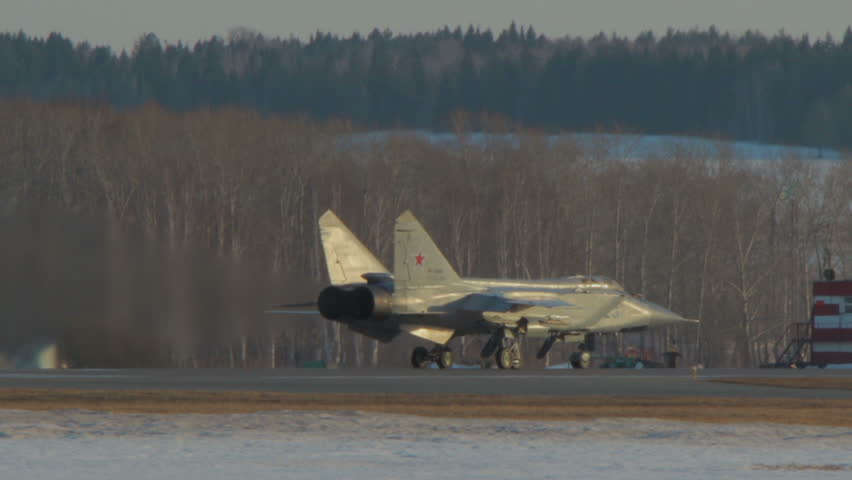 Takeoff of the MIG-31. Military supersonic interceptor aircraft the MIG-31 (Foxhound) of the Russian Air Force. A flame bursts during work of jet engines. The plan accelerates and takes off.
