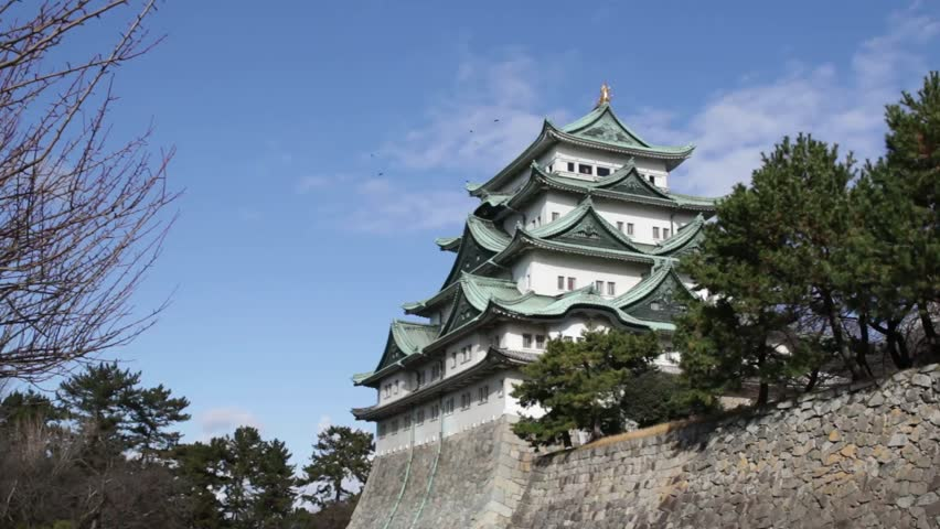 Nagoya castle in Japan during autumn fall seasons. Windy day at Castle tower of Nagoya castle in Japan.