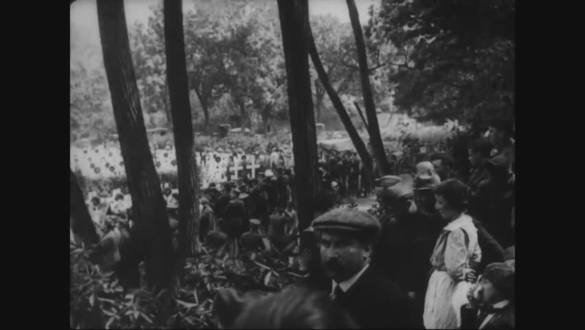 CIRCA - 1919 - Officers and officials in the presidential party of Woodrow Wilson gather near graves in a cemetery at Suresnes in France.
