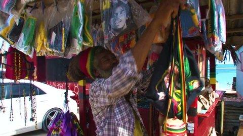 KINGSTON,  JAMAICA - CIRCA JUNE 2017 : Bob Marley goods sold at beach side near Kingston.