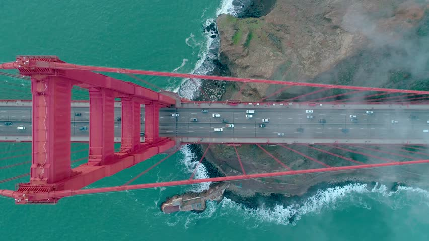 Golden Gate Bridge. Aerial of the Golden Gate Bridge in San Francisco in a misty day. View from top to bottom. Aerial. Drone. California, USA. 4k | Shutterstock HD Video #1006625659