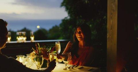 Couple enjoying romantic candle light dinner