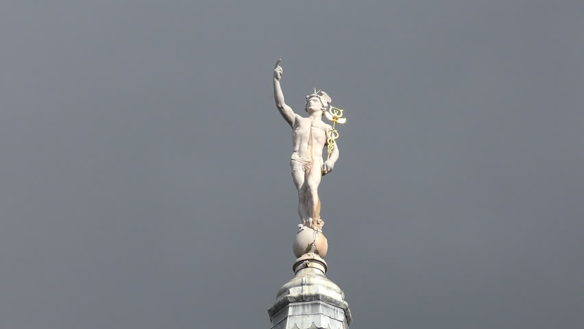 A statue of Hermes with Caduceus.
