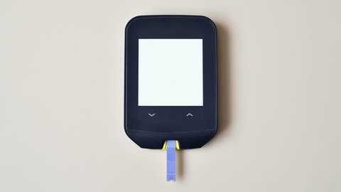 Glucose meter measuring blood sugar. High level. Hyperglicemia. Diabetes.