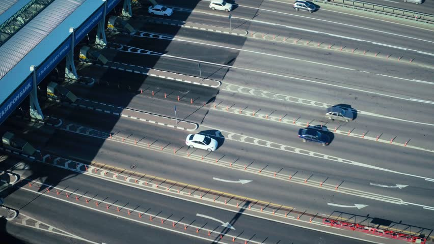 Drone view car traffic on checkpoint at toll road in modern city aerial view. Car driving on toll road for high speed and comfortable driving without traffic jams