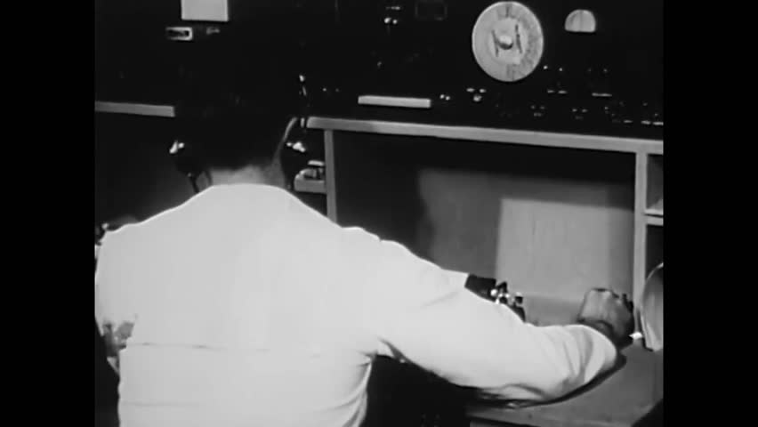 CIRCA 1944\xD1 A Navy radioman showcases Morse Code equipment.