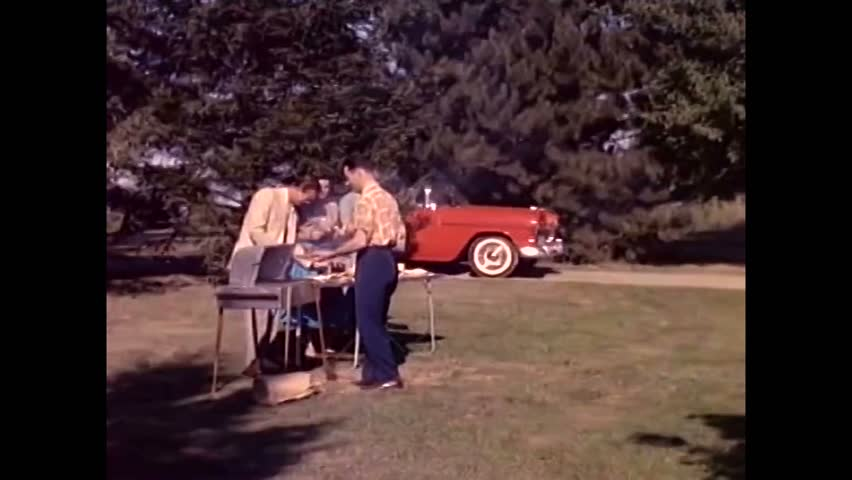 CIRCA 1955\xD1A brand new 1955 Motoramic Chevrolet is showcased, a couple drives to a picnic and a woman exists a 1955 Motoramic Chevrolet. | Shutterstock HD Video #1006646869