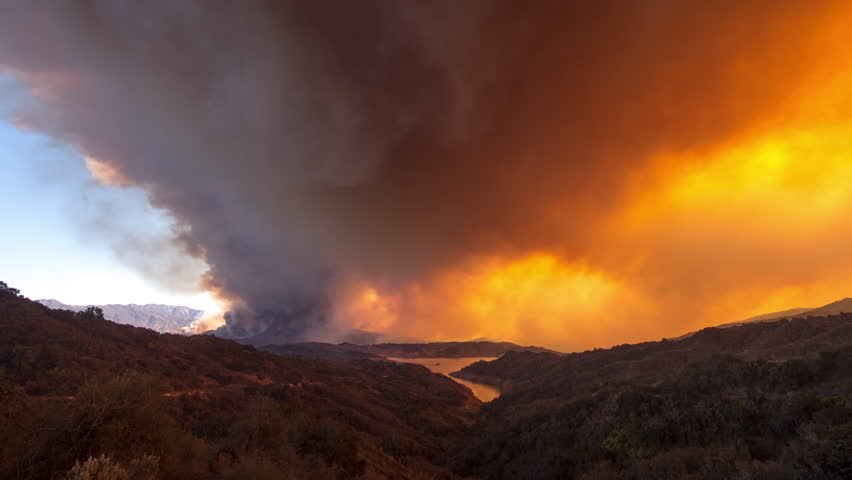 CIRCA 2010s - Remarkable time lapse of the huge Thomas Fire burning in the hills of Ventura County above Ojai, California.