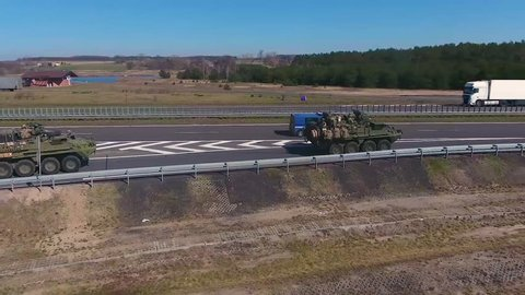 CIRCA 2010s - A NATO convoy led by American tanks moves along a European highway.