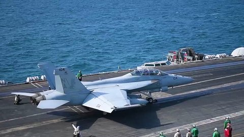 CIRCA 2010s - Navy jets take off from a U.S. aircraft carrier.