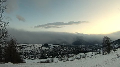 sunset over the mountains and small town of Zakopane