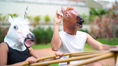 Horse and Unicorn playing on roundabout
