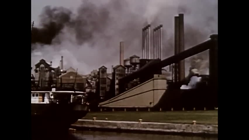 CIRCA 1953 - A shot of various factories, and a farmer works acreage with a Ford Golden Jubilee tractor. | Shutterstock HD Video #1006703209