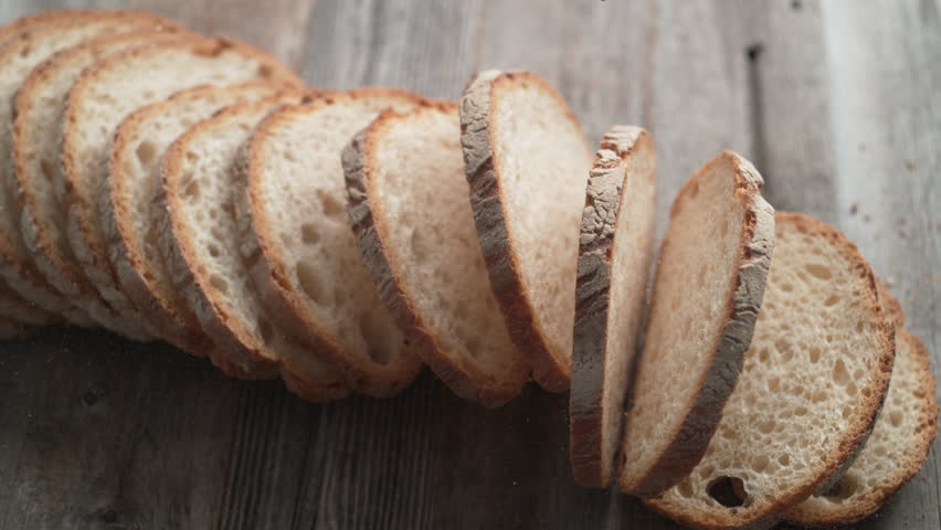 Sliced sourdough bread falling on a table. Shot with high speed camera, phantom flex 4K. Slow Motion. | Shutterstock HD Video #1006716889