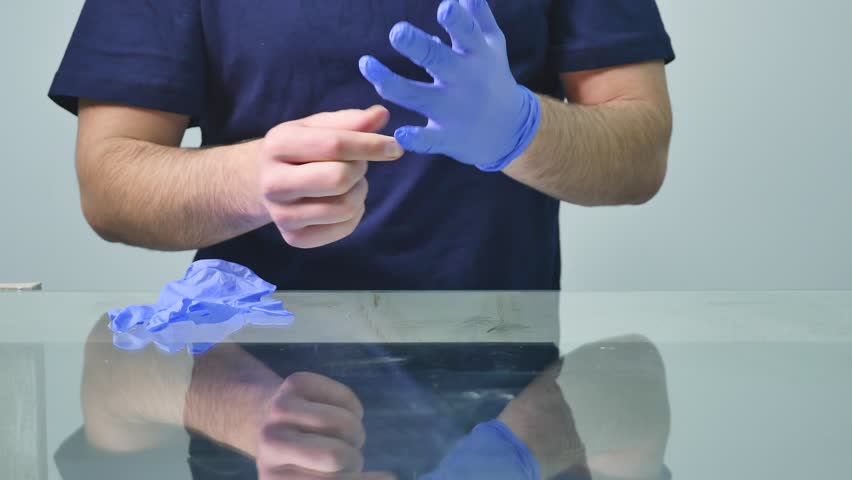 The doctor wears sterile latex gloves   Shutterstock HD Video #1006751899