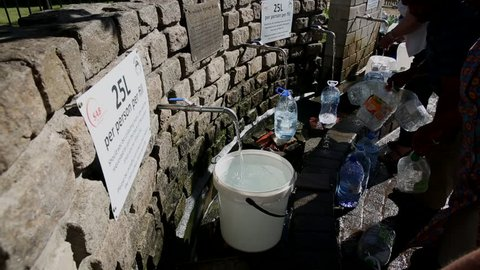 Cape Town / South Africa - January 25, 2018: People filling up natural spring water for drinking in Newlands in the drought in Cape Town South Africa