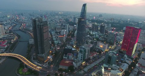 HO CHI MINH CITY, VIETNAM – MAY, 2016 : Aerial shot of central Ho Chi Minh cityscape at sunset with skyscraper and Saigon river in view