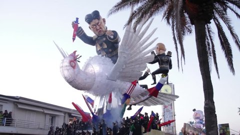 Viareggio, January 2018: Kim Jong-un and Dove of peace caricature in carnival parade of floats and masks, made of paper-pulp, on January 2018 in Viareggio, Tuscany, Italy