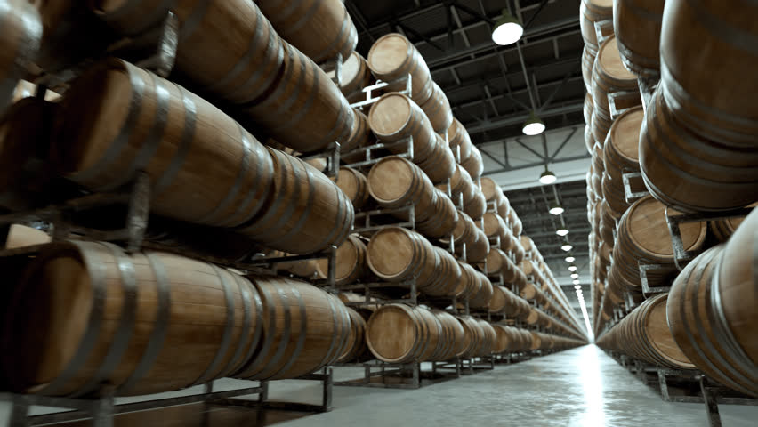 Whiskey or wine barrels stacked in rows at the warehouse
