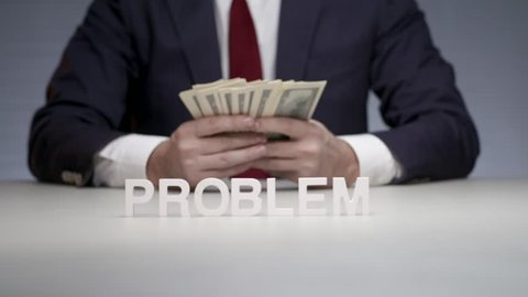 Word problem composed by letters standing on background man with bundle of money