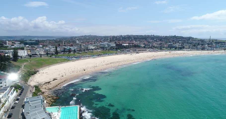 Landing on sandstone cliffs near Bondi beach overlooking rock pool, iceberg and Bondi waterfront.