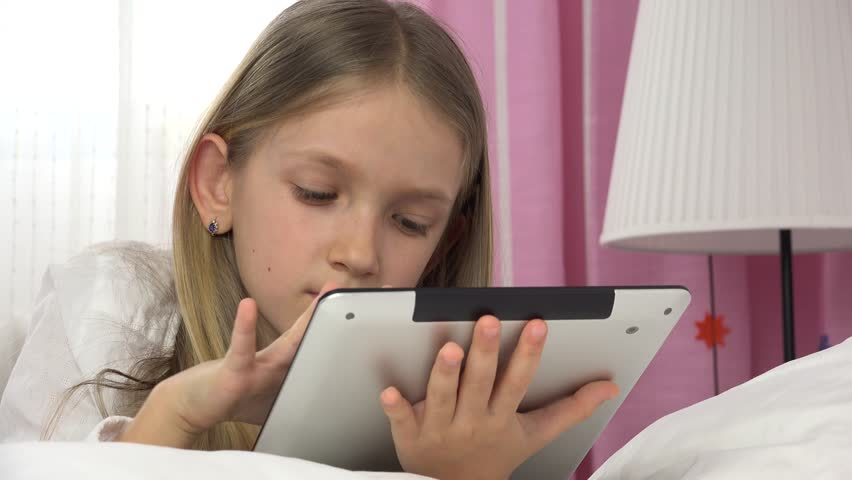Child Playing Tablet in Bed, Girl Portrait Relaxing on PC, Not Sleeping Kid 4K | Shutterstock HD Video #1006958419