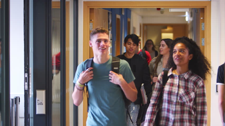 Group Of College Students Walking Through College Corridor | Shutterstock HD Video #1006964449