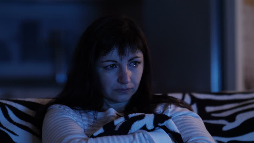 Woman watching TV and crying, tears of happiness, emotional movie | Shutterstock HD Video #1007000749