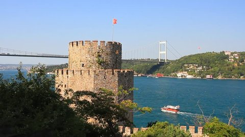 Rumeli Hisari Fortress with the FSM Bridge in the distance in Istanbul, Turkey. High angle view of Bosphorus from the castle