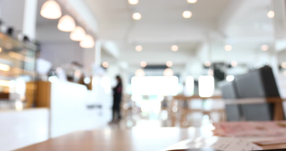 people in modern cafe restaurant, abstract blur scene background