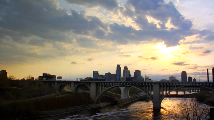 timelapse shot of downtown Minneapolis, MN at dusk with the Mississippi river in