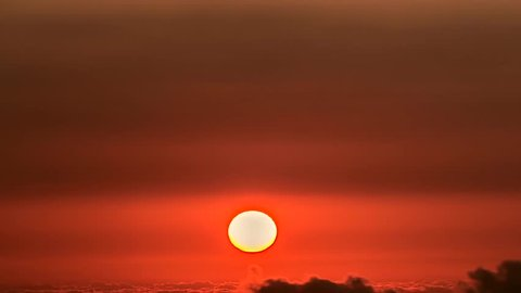 Evening clouds, sunset. Sun set sky clouds. Sky background. Sunset  orange. Skies dramatic. Beautiful epic scenic cumulus clouds rolling over sky background backlit, ULTRA HD.