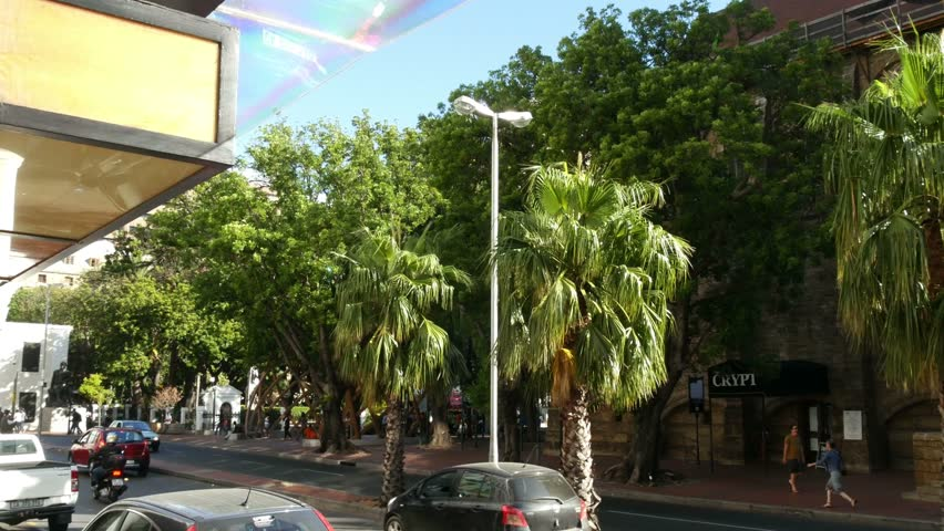CAPE TOWN, CIRCA FEB 2018, SOUTH AFRICA, Pan from Wale Street palm trees & traffic to Taj Hotel sign covered entrance & sidewalk reflections,building original reserve bank SA | Shutterstock HD Video #1007139739