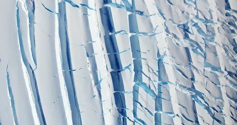 Very high-altitude overflight aerial of polar glacier crevasses . Clip loops and is reversible. Elements of this image furnished by NASA