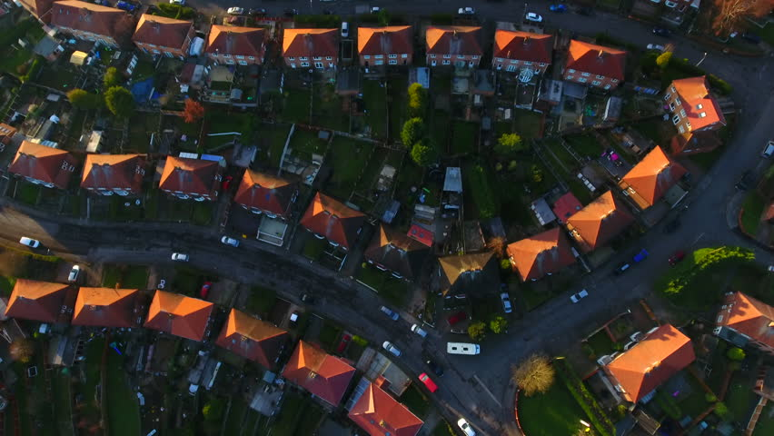 Aerial drone shot of British housing council estate in the UK, English house and homes from above, semi detached  | Shutterstock HD Video #1007160469