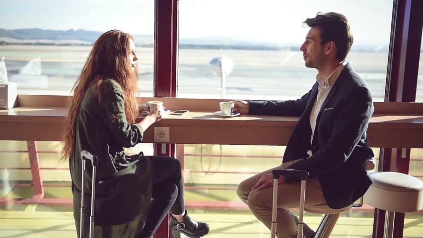 Couple enjoying coffee in airport | Shutterstock HD Video #1007169739