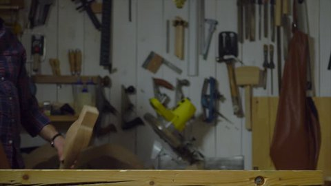 Joiner finished working on a cabrioli leg and shows it to us/Happy Carpenter Shows Cabrioli Leg