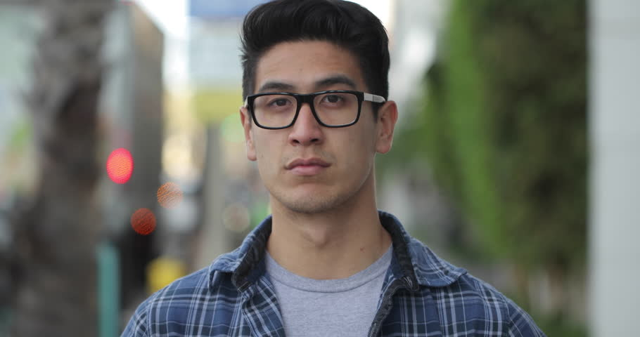 Young man in city serious face portrait   Shutterstock HD Video #1007204869