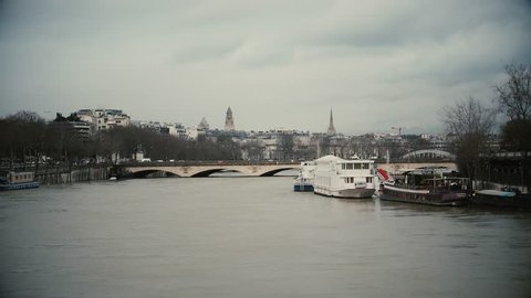 View from aerial still drone of pont d'Iena and swollen river Seine embankments overflow floodings in Paris - news footage - vintage film effect