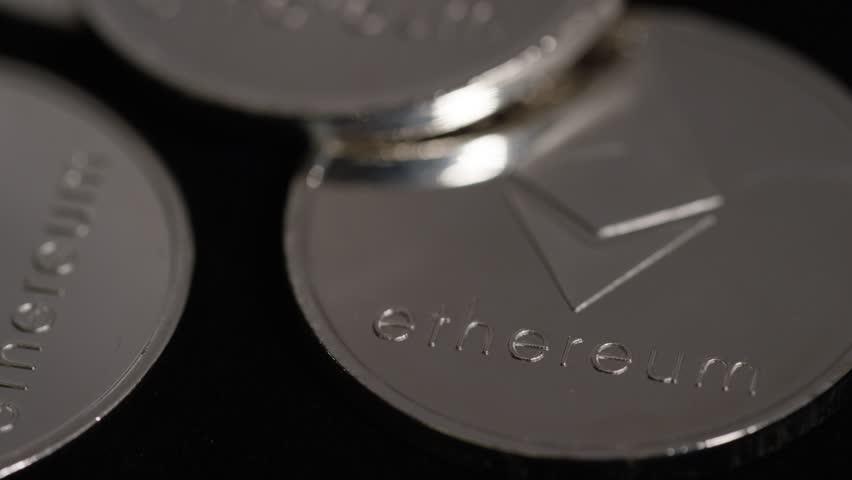 Ethereum tilt up reveal of coin on black background | Shutterstock HD Video #1007248309