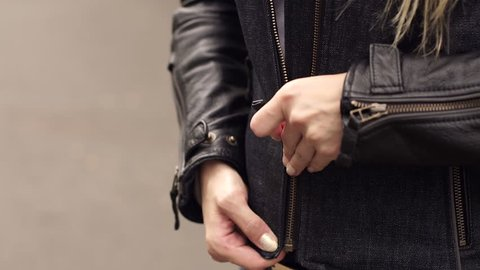 Biker girl rocker or punk in black leather jackets. Fastens with a zipper on the jacket.