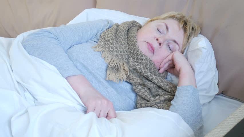 Woman is ill in bed  | Shutterstock HD Video #1007255689