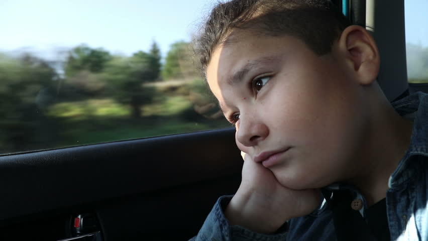 Little boy travelling in car and looking through the window   Shutterstock HD Video #1007274109