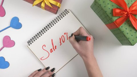 Valentine's Day, illustration, woman's hand writes in a notebook, sale 10 percent off 60 fps