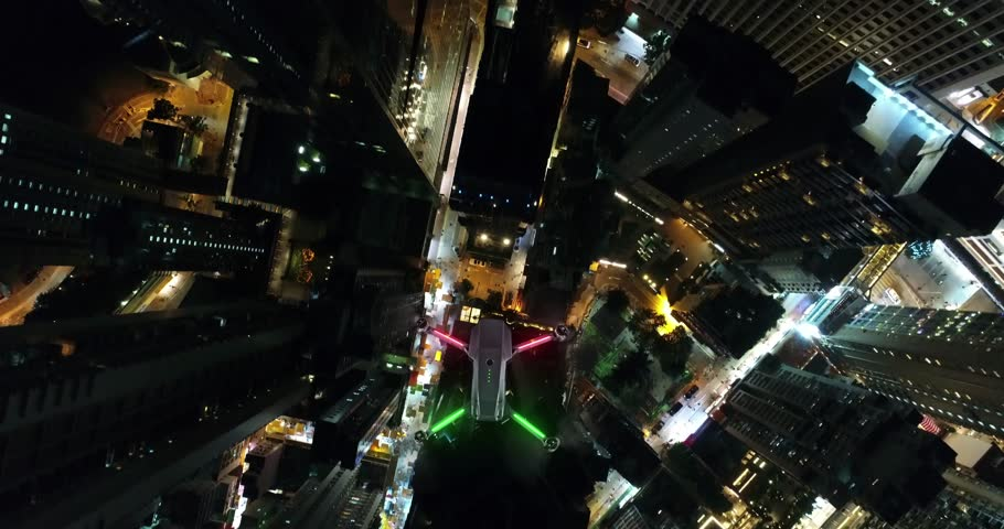 AERIAL. Animation of Drone (Multi-rotor) flying above the city panorama at night scene. | Shutterstock HD Video #1007325739
